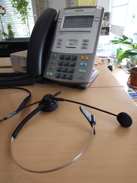 repetitive strain injury solution 7: earphone instead of telephone receiver to uncramp neck